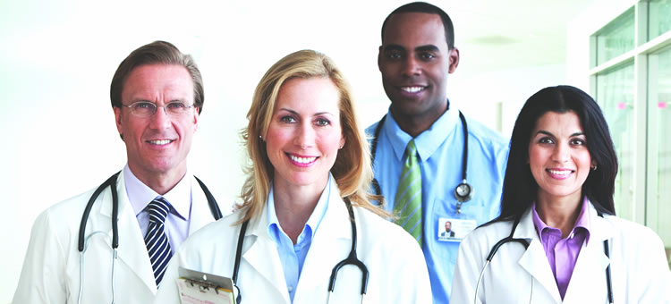 Image of four doctors standing together